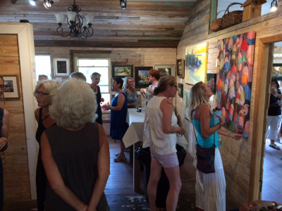 Guest admiring the art at Live Oak Gallery
