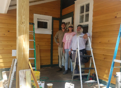 Group of 3 people working on the Live Oak Gallery
