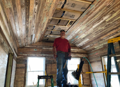 Man working on the ceiling at Live Oak Gallery