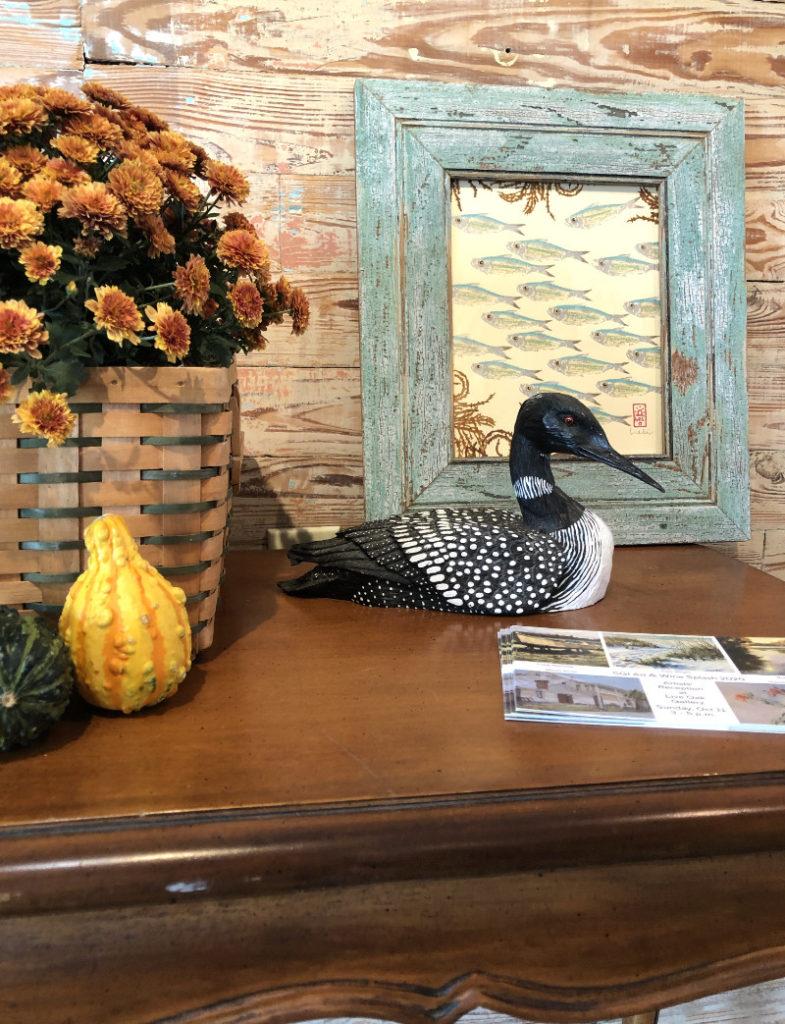 Dawn Wilkins Silversides School with Hook Weed adorns a fall sidetable